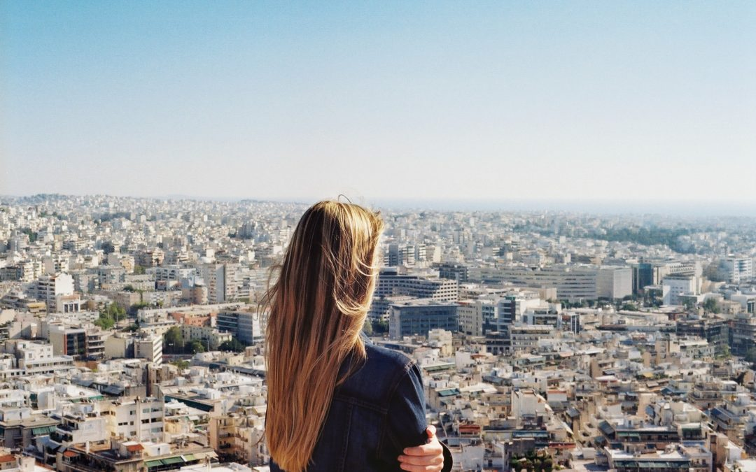 CEO woman overlooking city